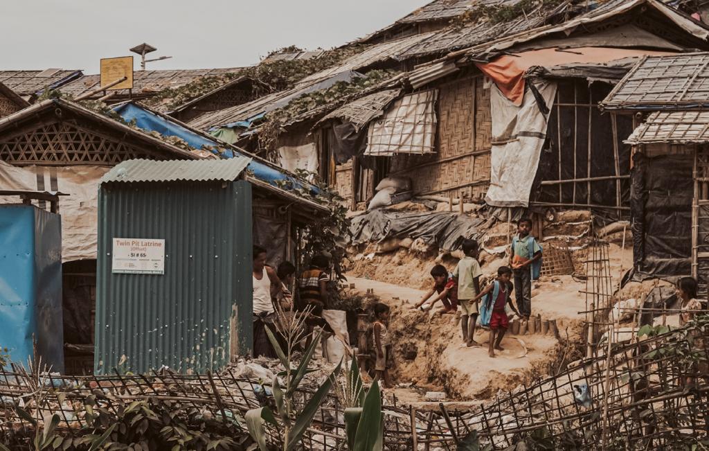 Children gather in a crowded slum in Bangladesh
